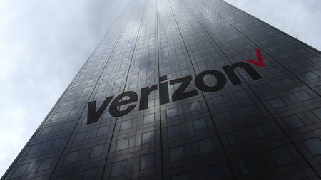 Verizon Communications logo on a skyscraper facade reflecting clouds. Editorial 3D rendering Редакционное