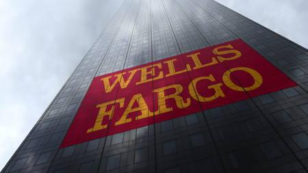 Wells Fargo logo on a skyscraper facade reflecting clouds. Editorial 3D rendering
