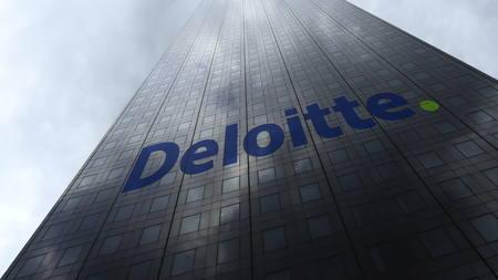 Deloitte logo on a skyscraper facade reflecting clouds. Editorial 3D rendering