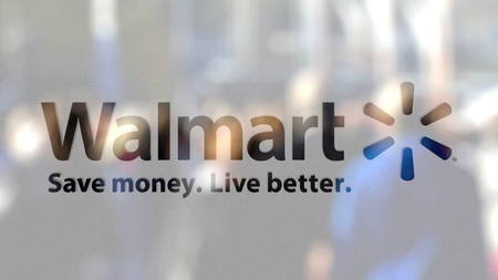 Walmart logo on a glass against blurred crowd on the steet. Editorial 3D rendering