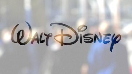 Walt Disney Pictures logo on a glass against blurred crowd on the steet. Editorial 3D rendering Editorial