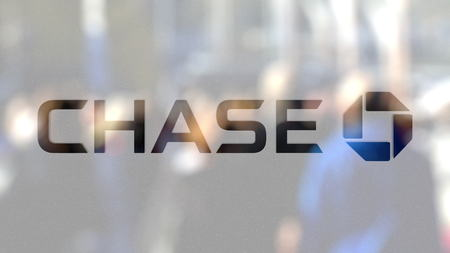 JPMorgan Chase Bank logo on a glass against blurred crowd on the steet. Editorial 3D rendering Publikacyjne