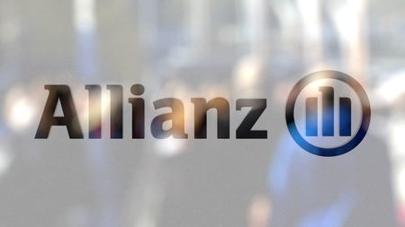 Allianz logo on a glass against blurred crowd on the steet. Editorial 3D rendering Editorial