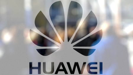 Huawei logo on a glass against blurred crowd on the steet. Editorial 3D rendering
