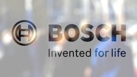 Robert Bosch GmbH logo on a glass against blurred crowd on the steet. Editorial 3D rendering