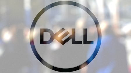 Dell Inc. logo on a glass against blurred crowd on the steet. Editorial 3D rendering Editorial