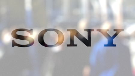 Sony Corporation logo on a glass against blurred crowd on the steet. Editorial 3D rendering