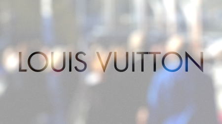 Louis Vuitton logo on a glass against blurred crowd on the steet. Editorial 3D rendering Editorial