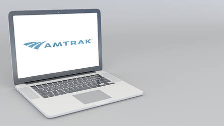 Opening and closing laptop with Amtrak logo. 4K editorial 3D rendering