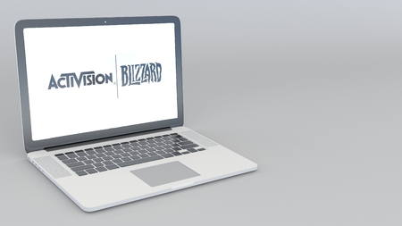 Opening and closing laptop with Activision Blizzard logo. 4K editorial 3D rendering Editorial
