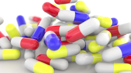 Falling colorful drug capsules or pills, shallow focus. 3D rendering