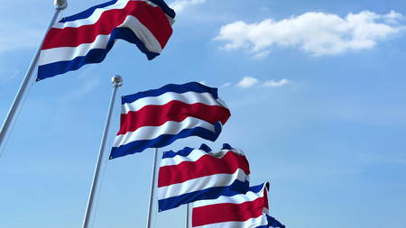 Multiple waving flags of Costa Rica against the blue sky. 3D rendering