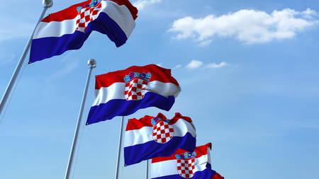 Multiple waving flags of Croatia against the blue sky. 3D rendering