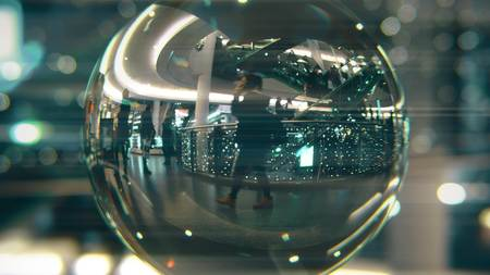 Customers walk in Christmas decorated shopping mall. View through the glass ball