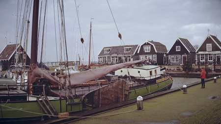 MARKEN, NETHERLANDS - DECEMBER 30, 2017. Moored sailboats and traditional houses Editorial