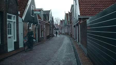 EDAM, NETHERLANDS - DECEMBER 30, 2017. POV walk along traditional Dutch town street