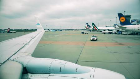 WARSAW, POLAND - DECEMBER 25, 2017. Commercial airplanes at the Chopin international airport, view from the porthole