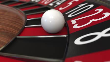 Casino roulette wheel ball hits 23 twenty-three red, close-up shot