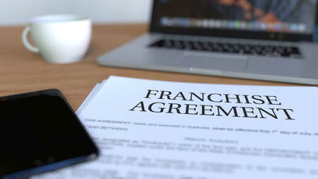 Copy of franchise agreement on the desk. 3D rendering