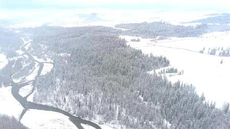 Aerial shot of a snowy winter scenery in southern Poland, the Tatra mountains 写真素材