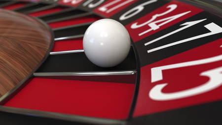 Casino roulette wheel ball hits 17 seventeen black. 3D rendering Foto de archivo