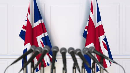British official press conference. Flags of the United Kingdom and microphones. Conceptual 3D rendering
