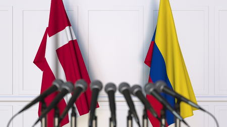 Flags of Denmark and Colombia at international meeting or conference. 3D rendering