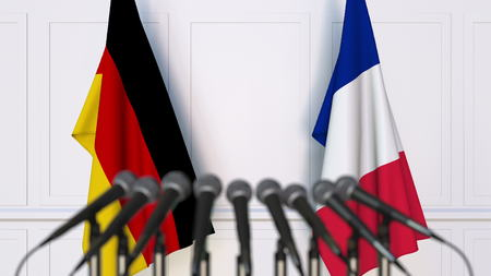 Flags of Germany and France at international meeting or conference. 3D rendering Stock Photo