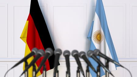 Flags of Germany and Argentina at international meeting or conference. 3D rendering Stock Photo