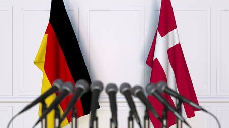 Flags of Germany and Denmark at international meeting or conference. 3D rendering