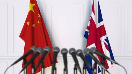 Flags of China and The United Kingdom at international meeting or conference. 3D rendering