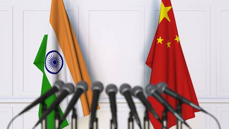 Flags of India and China at international meeting or conference. 3D rendering Stock Photo