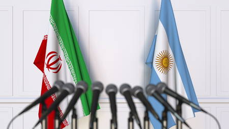 Flags of Iran and Argentina at international meeting or conference. 3D rendering Stock Photo