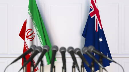 Flags of Iran and Australia at international meeting or conference. 3D rendering