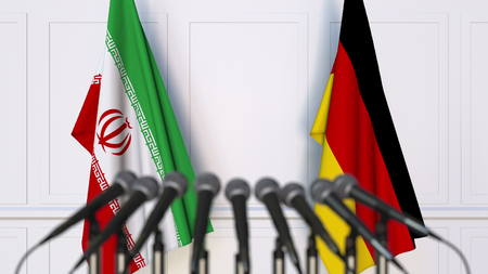 Flags of Iran and Germany at international meeting or conference. 3D rendering