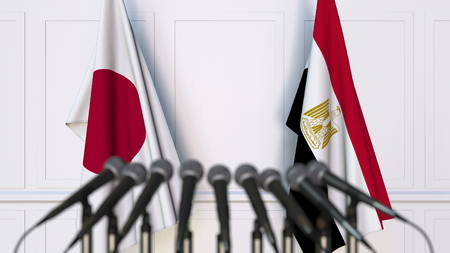 Flags of Japan and Egypt at international meeting or conference. 3D rendering Stock Photo