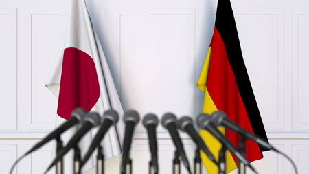 Flags of Japan and Germany at international meeting or conference. 3D rendering