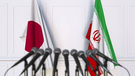 Flags of Japan and Iran at international meeting or conference. 3D rendering Stock Photo