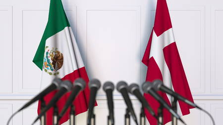Flags of Mexico and Denmark at international meeting or conference. 3D rendering