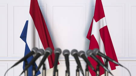 Flags of the Netherlands and Denmark at international meeting or conference. 3D rendering