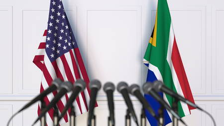 Flags of the USA and South Africa at international meeting or conference. 3D rendering