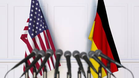 Flags of the USA and Germany at international meeting or conference. 3D rendering Stock Photo