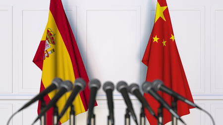 Flags of Spain and China at international meeting or conference. 3D rendering