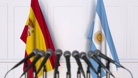 Flags of Spain and Argentina at international meeting or conference. 3D rendering Stock Photo