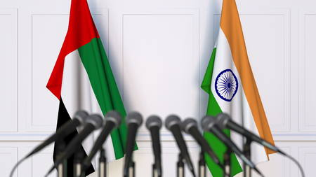 Flags of the UAE and India at international meeting or conference. 3D rendering Stock Photo