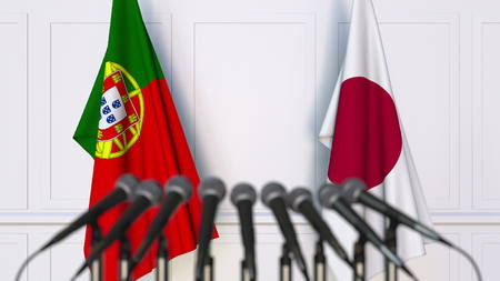 Flags of Portugal and Japan at international meeting or conference. 3D rendering