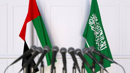 Flags of the UAE and Saudi Arabia at international meeting or conference. 3D rendering