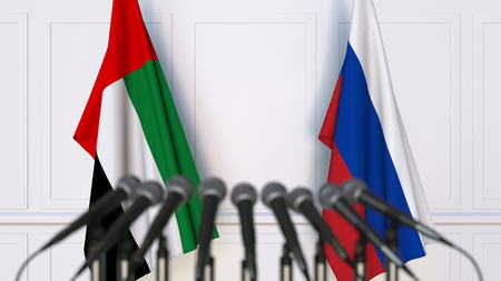 Flags of the UAE and Russia at international meeting or conference. 3D rendering Stock Photo