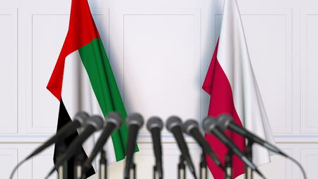Flags of the UAE and Poland at international meeting or conference. 3D rendering Stock Photo