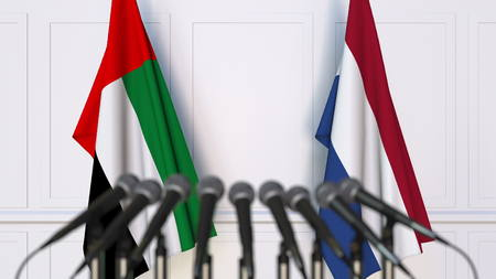 Flags of the UAE and Netherlands at international meeting or conference. 3D rendering Stock Photo